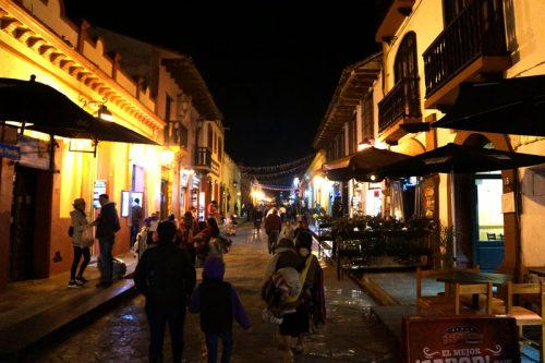 Streets at night with lots of restaurants