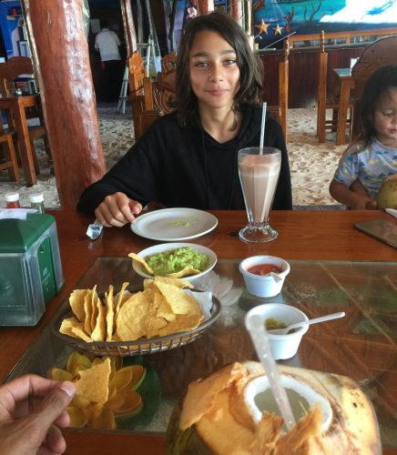 Guacamole and coconuts at beach side restaurant