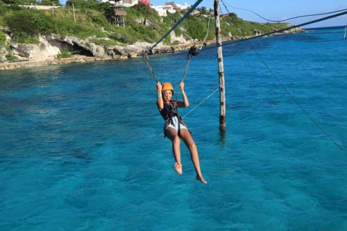Zip lining over the reef at Garafon