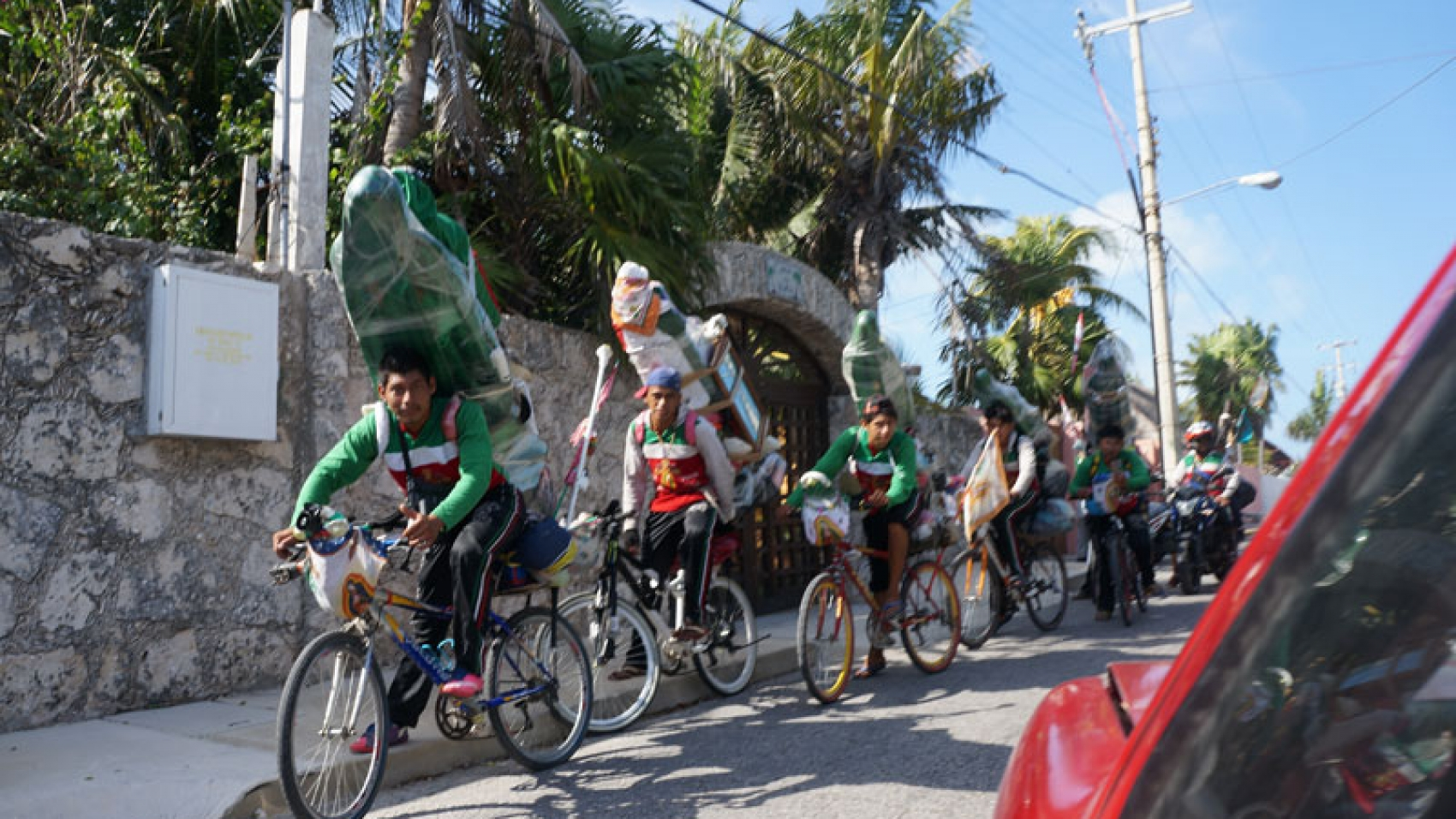 Locals carrying statues of Mary of Guadalupe on their back in preparation for the upcoming festival