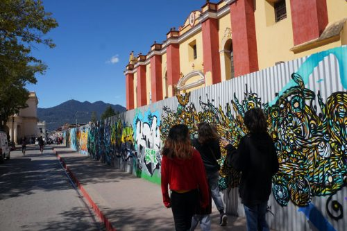 The murals on the construction wall
