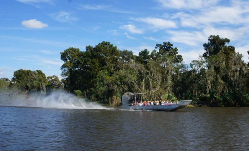 Air boat whizzing past our Bayou boat