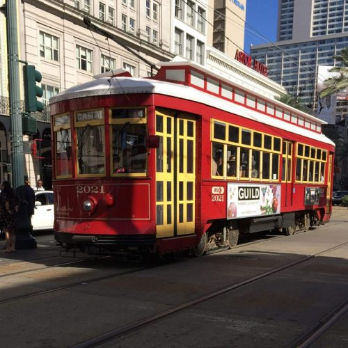 "Red tram or ""Street Car"" as it is called in New Orleans"
