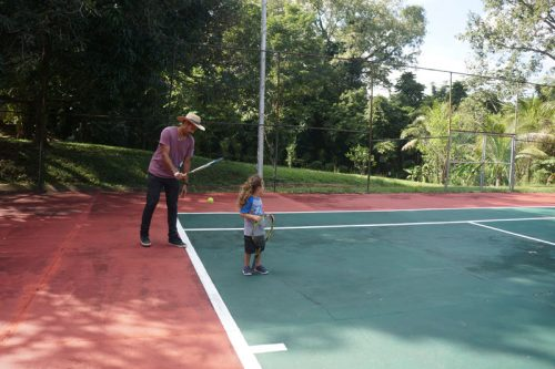 Kenzo learning to play tennis