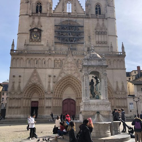 Cathédrale Saint-Jean-Baptiste in the medieval area of Lyon has square in front with a statue dedicated to a saint